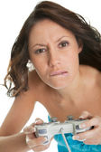 Young woman concentrated on videogame — Stock Photo