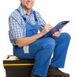 Confident service man taking notes - Stockfoto