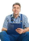 Confident service man taking notes — Stock Photo