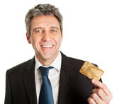 Businessman holding credit card — Stock Photo