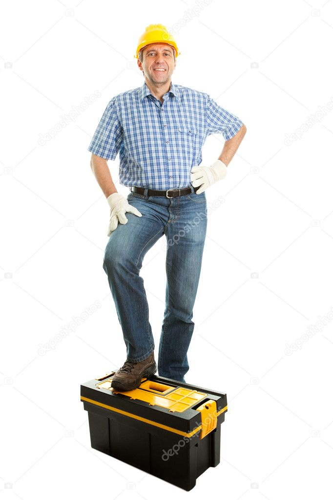 Confident repairman wearing hard hat and standing on toolbox. Isolated on white — Photo #5178717