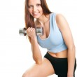 Fitness woman exercising with dumpbells — Stock Photo