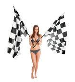 Beautilful garota agitando bandeiras de corrida — Foto Stock