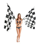 Beautilful garota agitando bandeiras de corrida — Fotografia Stock