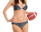 Beautilful woman posing with football ball — Stock Photo