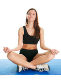 Fitness woman sitting in lotus yoga position — Stock Photo