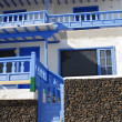 Stock Photo: White villwith blue balcony