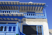 White and blue villa with balcony — Stock Photo