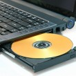Laptop and DVD isolated on white - Stock Photo