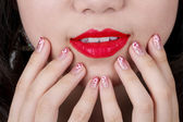 Red lips and nail art — Stock Photo