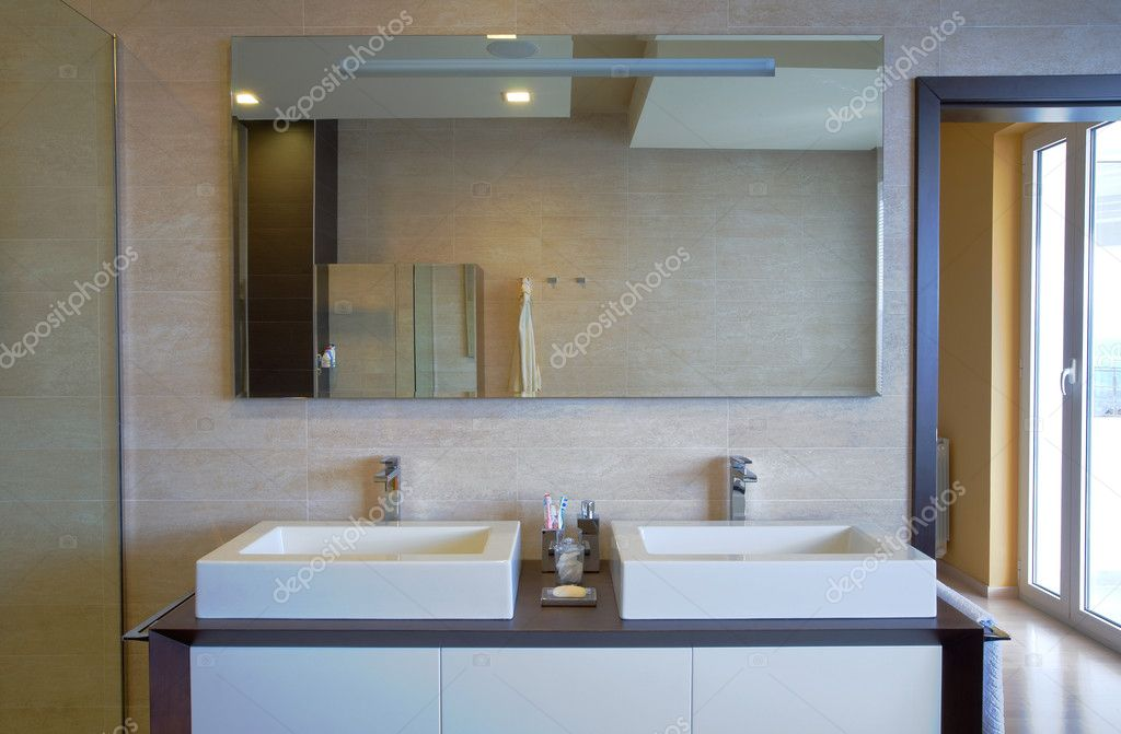 Modern house bathroom interior with simple and expensive furniture.  Stock Photo #4641304
