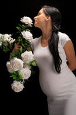 Pregnant with roses — Stock Photo