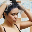 Woman dyeing hairs - Stock Photo