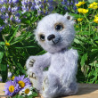 Teddy-bear Chupa among flowers - Stockfoto