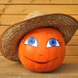 Pumpkin with female face in straw hat — Stock Photo