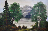 Trees on the bank of mountain lake — Stock Photo