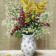 Wild flowers in a white vase — Stock Photo