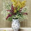 Wild flowers in a white vase — Stock Photo #5369885