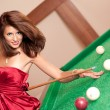 Woman playing billiards — Stock Photo
