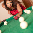 Woman playing billiards — Stock Photo #4177985