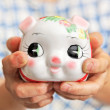 Save money with piggy bank — Stock Photo
