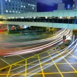 Traffic at night in busy city — Stock Photo