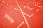 Numbers on running track — Stock Photo