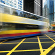Stock Photo: Bus speeding through street