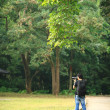 Stock Photo: Photographer in country side