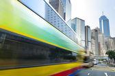 Bus speeding through the street — Stock Photo