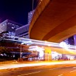 Light trails in mega city — Stock Photo