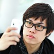 Young man taking picture with mobile phone — Stock Photo