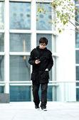 Man check the cell when walk — Stock Photo