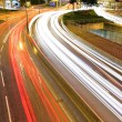Traffic trought downtown at night — Stock Photo #5008012