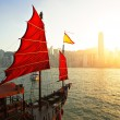 Sailboat in Hong Kong harbor - Stock Photo