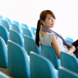 Sporty girl sit in sport arena — Stock Photo