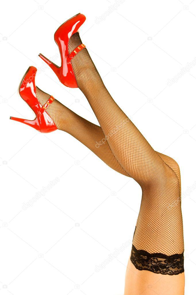 Красивые женские ножки в красных туфлях Фотография