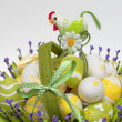 Basket with colourful eggs and a cock — Stock Photo