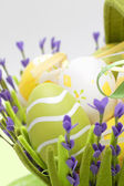 Basket with colourful eggs — Stock Photo