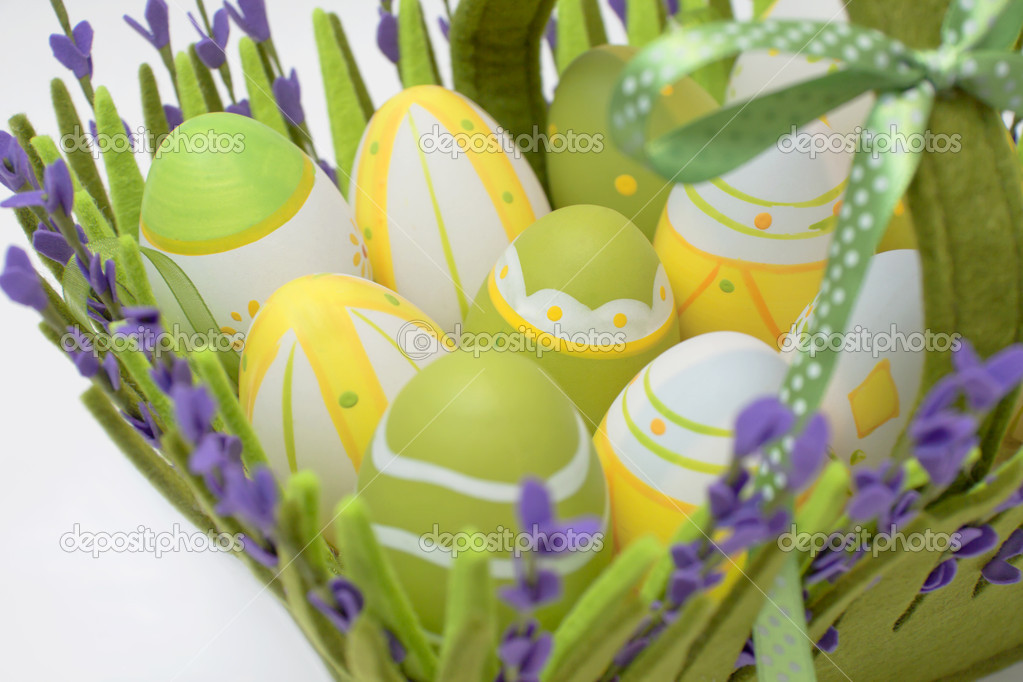 Multi-coloured eggs in a basket from a fabric from colour — Stock Photo #5287078