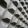 Stock Photo: Square concret shapes project out of side wall