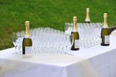 Champagne and cups — Stock Photo