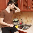 Guy in the kitchen doing the dishes — Foto Stock