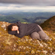 Royalty-Free Stock Photo: Snooze on top of the world 02