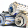Rolled up magazines — Stock Photo