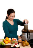 Woman making fruit juice — Stock Photo