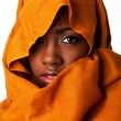 Mysterious female face in ocher head wrap - Zdjęcie stockowe