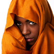 Mysterious female face in ocher head wrap - Stockfoto