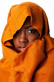 Mysterious female face in ocher head wrap — Stock Photo