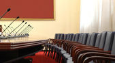 Conference room with microphones — Stock Photo